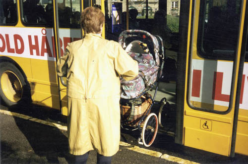 Stroller loading onto a low-floor bus
